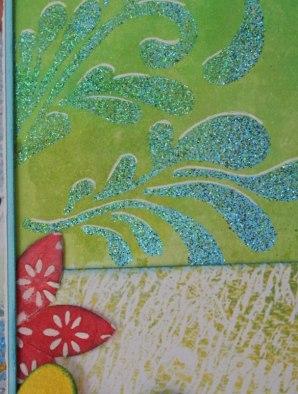 """Pochoirs """"Entre filles"""" pour les doodlings en poudre à embosser vert et bleu pailleté.  La fleur a été décoré avec un des pochoirs de la même série et de la Wepam."""